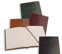 assortment of hard cover leather journals